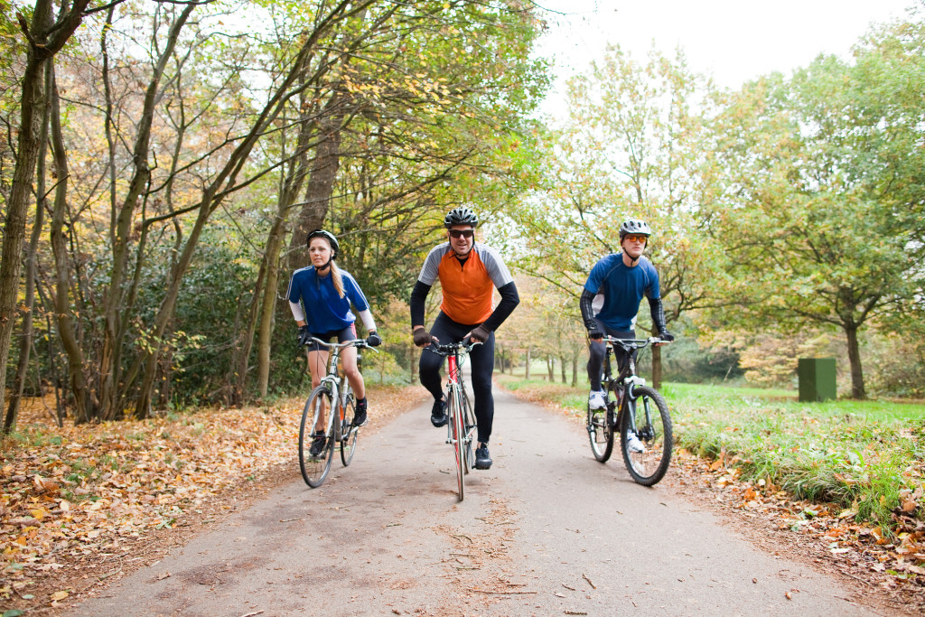 Three cyclists on a cycle track in Lancashire exploring the area