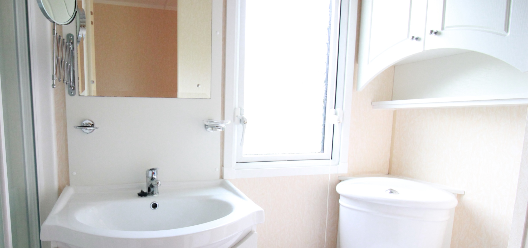 small bathroom with sink toliet and window