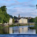 The River Kent, Kendal, Cumbria, England, with the clocktower of the Town Hall in the background